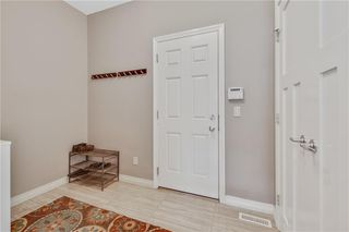 Photo 11: 583 Everbrook Way SW in Calgary: Evergreen Detached for sale : MLS®# A1033176