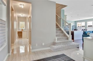 Photo 7: 583 Everbrook Way SW in Calgary: Evergreen Detached for sale : MLS®# A1033176