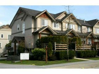 Photo 1: 10 1055 RIVERWOOD Gate in Port Coquitlam: Riverwood Townhouse for sale : MLS®# V998135
