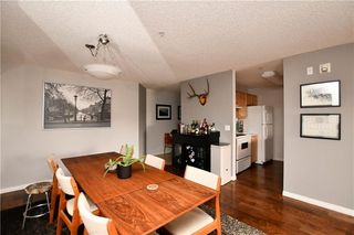 Photo 6: #209 2022 CANYON MEADOWS DR SE in Calgary: Queensland Condo for sale : MLS®# C4245571