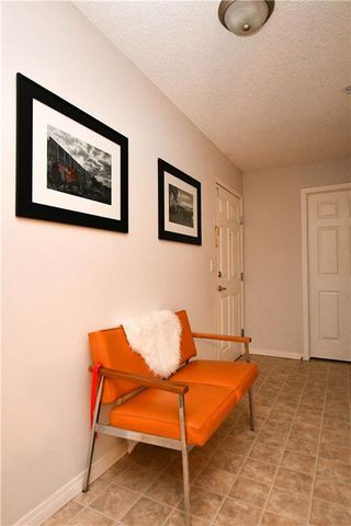 Photo 3: #209 2022 CANYON MEADOWS DR SE in Calgary: Queensland Condo for sale : MLS®# C4245571