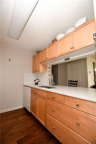 Photo 12: #209 2022 CANYON MEADOWS DR SE in Calgary: Queensland Condo for sale : MLS®# C4245571