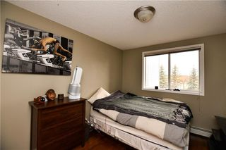 Photo 21: #209 2022 CANYON MEADOWS DR SE in Calgary: Queensland Condo for sale : MLS®# C4245571