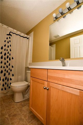 Photo 23: #209 2022 CANYON MEADOWS DR SE in Calgary: Queensland Condo for sale : MLS®# C4245571