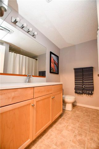 Photo 20: #209 2022 CANYON MEADOWS DR SE in Calgary: Queensland Condo for sale : MLS®# C4245571