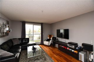 Photo 8: #209 2022 CANYON MEADOWS DR SE in Calgary: Queensland Condo for sale : MLS®# C4245571
