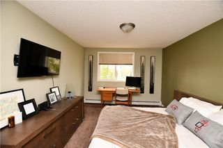 Photo 18: #209 2022 CANYON MEADOWS DR SE in Calgary: Queensland Condo for sale : MLS®# C4245571