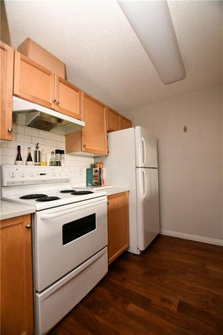Photo 11: #209 2022 CANYON MEADOWS DR SE in Calgary: Queensland Condo for sale : MLS®# C4245571