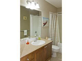 Photo 8: 71 EVERSYDE Heath SW in CALGARY: Evergreen Residential Attached for sale (Calgary)  : MLS®# C3507346