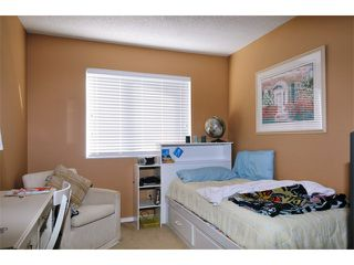 Photo 8: 1245 BLUFF Drive in Coquitlam: River Springs House for sale : MLS®# V975554