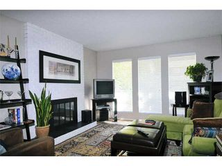 Photo 2: 1245 BLUFF Drive in Coquitlam: River Springs House for sale : MLS®# V975554