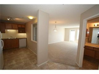 Photo 4: 2206 928 ARBOUR LAKE Road NW in CALGARY: Arbour Lake Condo for sale (Calgary)  : MLS®# C3562177