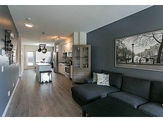 Photo 2: # 11 1219 BURKE MOUNTAIN ST in Coquitlam: Burke Mountain Condo for sale : MLS®# V1118478