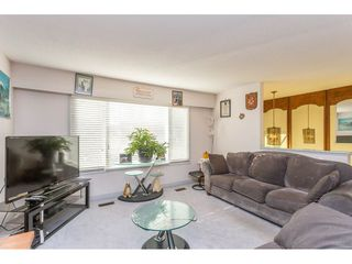 Photo 5: 9358 PRINCE CHARLES Boulevard in Surrey: Queen Mary Park Surrey House for sale : MLS®# R2417764