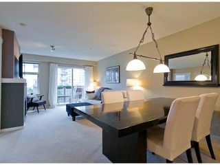 Photo 1: 208 500 KLAHANIE Drive in Port Moody: Port Moody Centre Condo for sale : MLS®# V988656