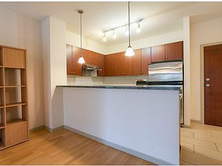 Photo 3: # 311 200 CAPILANO RD in Port Moody: Port Moody Centre Condo for sale : MLS®# V1032496
