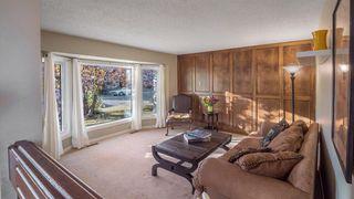 Photo 3: 145 Woodglen Way SW in Calgary: Woodbine Detached for sale : MLS®# A1041801