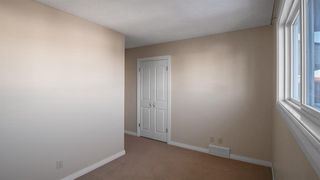 Photo 17: 145 Woodglen Way SW in Calgary: Woodbine Detached for sale : MLS®# A1041801