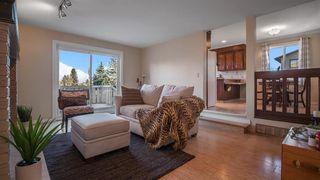 Photo 7: 145 Woodglen Way SW in Calgary: Woodbine Detached for sale : MLS®# A1041801