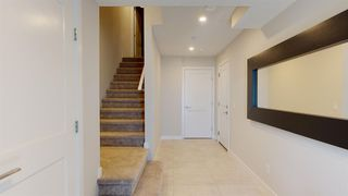 Photo 10: 107 Crestridge Common SW in Calgary: Crestmont Row/Townhouse for sale : MLS®# A1048110