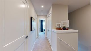 Photo 9: 107 Crestridge Common SW in Calgary: Crestmont Row/Townhouse for sale : MLS®# A1048110