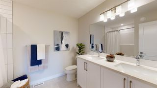 Photo 7: 107 Crestridge Common SW in Calgary: Crestmont Row/Townhouse for sale : MLS®# A1048110