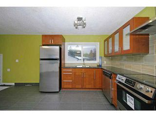 Photo 4: 615 34 Avenue NE in CALGARY: Winston Heights Mountview Residential Detached Single Family for sale (Calgary)  : MLS®# C3549154