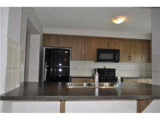 Photo 6: 36 WINDSTONE Green SW: Airdrie Townhouse for sale : MLS®# C3572091
