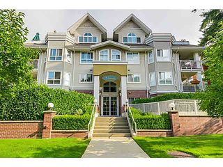 "Photo 1: 104 130 W 22ND Street in North Vancouver: Central Lonsdale Condo for sale in ""THE EMERALD"" : MLS®# V1080860"