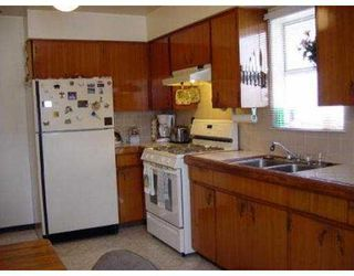 Photo 3: 4617 - 4619 UNION ST in Burnaby: Capitol Hill BN House Duplex for sale (Burnaby North)  : MLS®# V547433