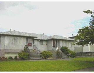 Photo 1: 4617 - 4619 UNION ST in Burnaby: Capitol Hill BN House Duplex for sale (Burnaby North)  : MLS®# V547433