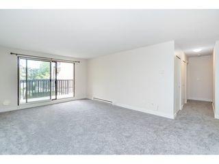 """Photo 10: 101 15288 100 Avenue in Surrey: Guildford Condo for sale in """"Cedar Grove"""" (North Surrey)  : MLS®# R2389430"""