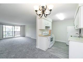 """Photo 3: 101 15288 100 Avenue in Surrey: Guildford Condo for sale in """"Cedar Grove"""" (North Surrey)  : MLS®# R2389430"""