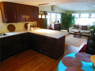 "Photo 2: 23 4200 DEWDNEY TRUNK Road in Coquitlam: Ranch Park Manufactured Home for sale in ""HIDEWAY PARK"" : MLS®# V984553"