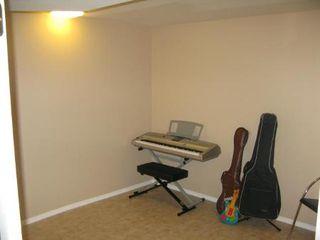 Photo 15: Charming 4 Bedroom Bungalow