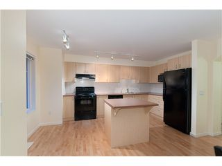 "Photo 8: 7 2351 PARKWAY Boulevard in Coquitlam: Westwood Plateau Townhouse for sale in ""WIND DANCE"" : MLS®# V960053"
