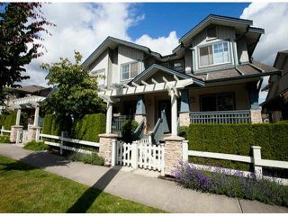 "Photo 1: 15 19250 65TH Avenue in Surrey: Clayton Townhouse for sale in ""Sunberry Court"" (Cloverdale)  : MLS®# F1416410"