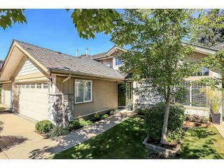 """Photo 1: 15053 27A Avenue in Surrey: Sunnyside Park Surrey Townhouse for sale in """"DAVENTRY"""" (South Surrey White Rock)  : MLS®# F1421884"""