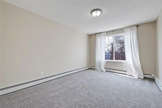 Photo 18: #201 15320 BANNISTER RD SE in Calgary: Midnapore Condo for sale : MLS®# C4201654
