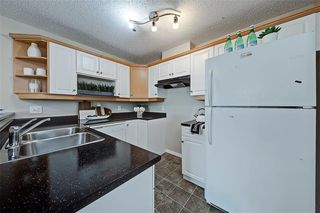 Photo 3: #201 15320 BANNISTER RD SE in Calgary: Midnapore Condo for sale : MLS®# C4201654