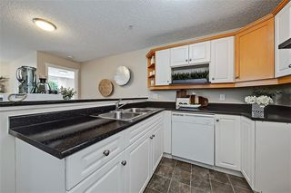 Photo 4: #201 15320 BANNISTER RD SE in Calgary: Midnapore Condo for sale : MLS®# C4201654