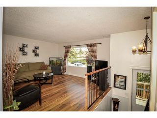 Photo 11: 41 GLENDALE WY: Cochrane House for sale : MLS®# C4026593