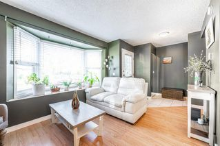 Photo 8: 501 7 Avenue NE in Calgary: Renfrew Row/Townhouse for sale : MLS®# A1034803