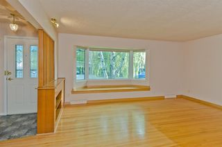 Photo 6: 1016 78 Avenue SW in Calgary: Chinook Park Detached for sale : MLS®# A1051571