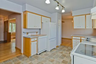 Photo 11: 1016 78 Avenue SW in Calgary: Chinook Park Detached for sale : MLS®# A1051571