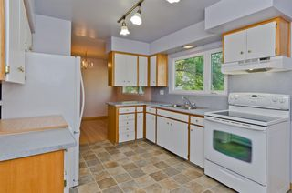 Photo 10: 1016 78 Avenue SW in Calgary: Chinook Park Detached for sale : MLS®# A1051571