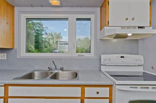 Photo 12: 1016 78 Avenue SW in Calgary: Chinook Park Detached for sale : MLS®# A1051571