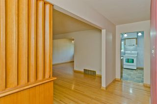Photo 2: 1016 78 Avenue SW in Calgary: Chinook Park Detached for sale : MLS®# A1051571