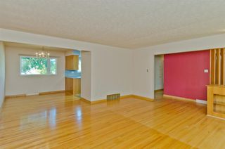 Photo 4: 1016 78 Avenue SW in Calgary: Chinook Park Detached for sale : MLS®# A1051571
