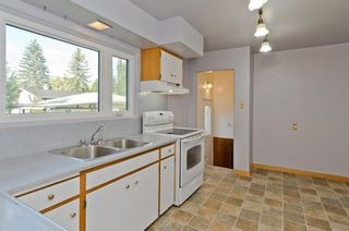 Photo 9: 1016 78 Avenue SW in Calgary: Chinook Park Detached for sale : MLS®# A1051571